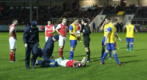Daryl Kavanagh in pain as David McMillan argues with referee Neil Doyle (Photo courtesy of Rebecca Duffy)