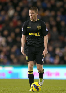 RoI midfielder playing in Wigan's away colours