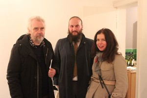Three art fans at gallery opening