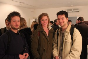 Three students at gallery opening