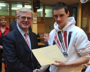 Eamonn Gilmore presenting Junior Cert results to a student from Clonmel High School in 2008 -Credit Flickr- The Irish Labour Party