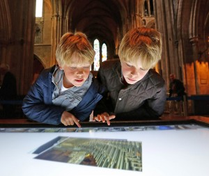 5/8/15***NO REPRO FEE*** Dylan aged 10 and Oliver Woods aged 13 from Wicklow pictured at the launch of Saint Patrick's Cathedral's new discovery space, an interactive interpretive centre in the south transept this morning. The new centre is part funded by Fáilte Ireland and includes a large touch screen table featuring interactive content on the building's history; brass rubbings; a large jigsaw of one of the windows of the Cathedral; a small reference library; an AV unit; and a number of touch screen computers featuring the Cathedral's app. The new area fuses the history of the Cathedral with modern technology, with many of the new elements made from 19th Century carved oak pews from the building. For further information on the Cathedral, visit www.stpatrickscathedral.ie. Pic: Marc O'Sullivan